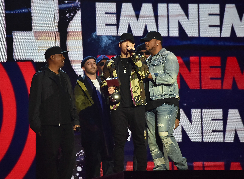 Eminem accepts his award at the
