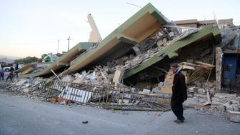 SULAYMANIYAH, IRAQ - NOVEMBER 13: A collapsed house is seen, after a 7.3 magnitude earthquake hit northern Iraq, in Derbendihan district of Sulaymaniyah, Iraq on November 13, 2017. An earthquake measuring 7.3 on the Richter scale rocked northern Iraq and Iran, the U.S. Geological Survey said on Sunday evening. At least 61 people were killed and more than 300 others injured in Iran's border areas, according to information provided by the concerned authorities, said Iran's semi-official Fars News Agency. (Photo by Yunus Keles/Anadolu Agency/Getty Images)
