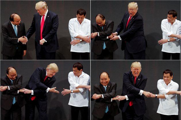 Trump breaks the link as handshake photo op goes awry