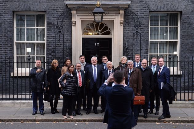 Business leaders from Europe and the UK pose for a group photo as they leave 10 Downing Street, London,...