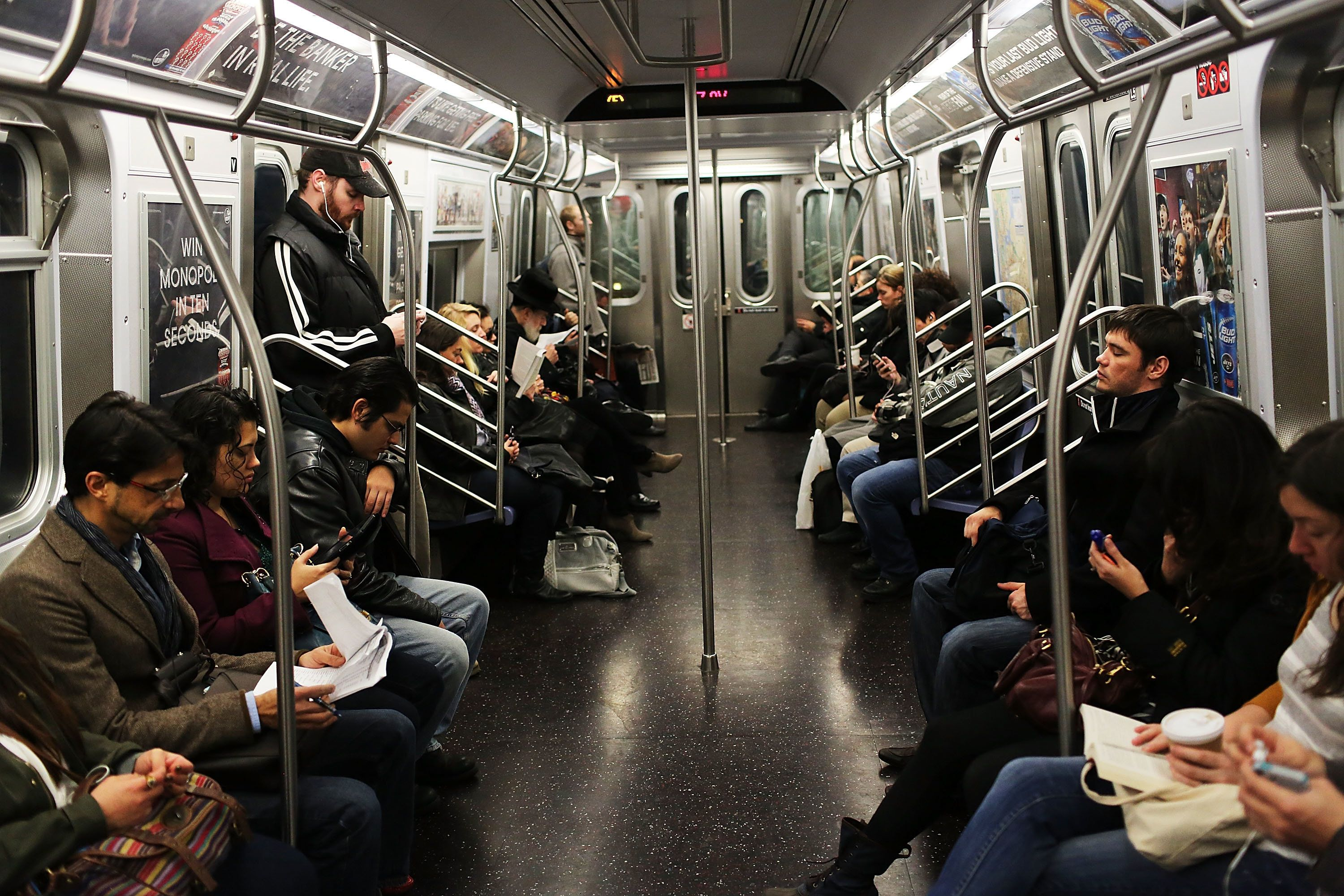 NEW YORK, NY - DECEMBER 05:  Passengers ride in a subway car two days after a man was pushed to his death in front of a train on December 5, 2012 in New York City. The incident was caught by a photographer and has since raised questions as to why someone didn't help the man before the train struck him. The New York City subway system, with 468 stations in operation, is the most extensive public transportation system in the world. It is also one of the world's oldest public transit systems, with the first underground line of the subway opening on October 27, 1904.  (Photo by Spencer Platt/Getty Images)
