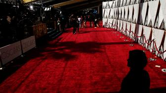 A woman watches over the red carpet outside the Dolby Theatre as preparations continue for the 89th Academy Awards in Hollywood, Los Angeles, California, U.S., February 25, 2017.  REUTERS/Lucas Jackson