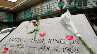 Flowers lie on the plaque that lays at Lorraine Motel, now part of the National Civil Rights Museum, where Rev. Dr. Martin Luther King Jr. was assassinated in 1968 in Memphis, April 4, 2008. April 4th marks the 40th anniversary of the assassination of the civil rights leader who was shot as he stood on the balcony of the Lorraine Motel.    REUTERS/Mike Segar   (UNITED STATES)