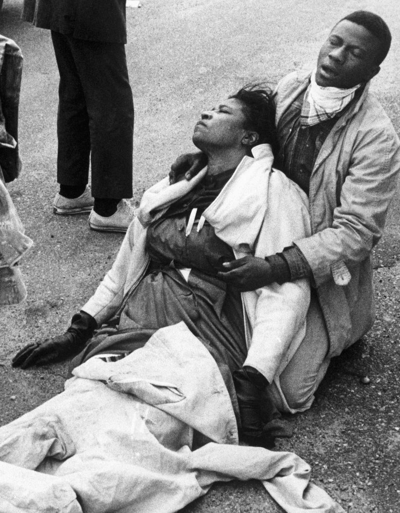 Mrs. Boynton Robinson with a fellow marcher in 1965 after being knocked unconscious and gassed by Alabama troopers at the  Ed