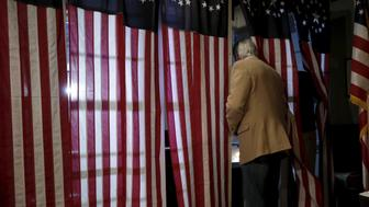 A voter enters a voting booth to fill out a ballot in the U.S. Presidential primary election at the Hale House at Balsams Hotel in Dixville Notch, New Hampshire, February 9, 2016. Since 1960 residents of Dixville New Hampshire cast the first election day ballots of the U.S. presidential election moments after midnight. REUTERS/Mike Segar
