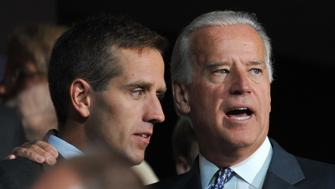 Democratic vice presidential nominee Sen. Joe Biden (R) is seen with his son Beau Biden at the Democratic National Convention 2008 at the Pepsi Center in Denver, Colorado, on August 25, 2008. The Democrats formally opened their convention to crown Barack Obama as the first black presidential election nominee. The DNC is held 25-28 August. AFP PHOTO Paul J. RICHARDS (Photo credit should read PAUL J. RICHARDS/AFP/Getty Images)