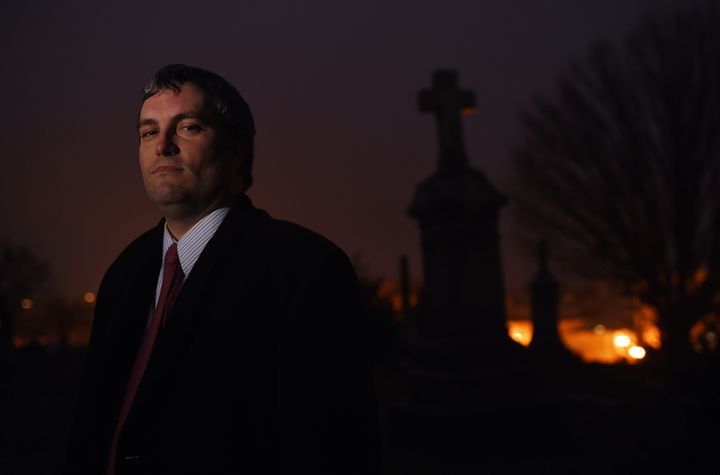 Here's Brett Talley posing for a portrait in a cemetery. In addition to being nominated to a lifetime court seat for some rea