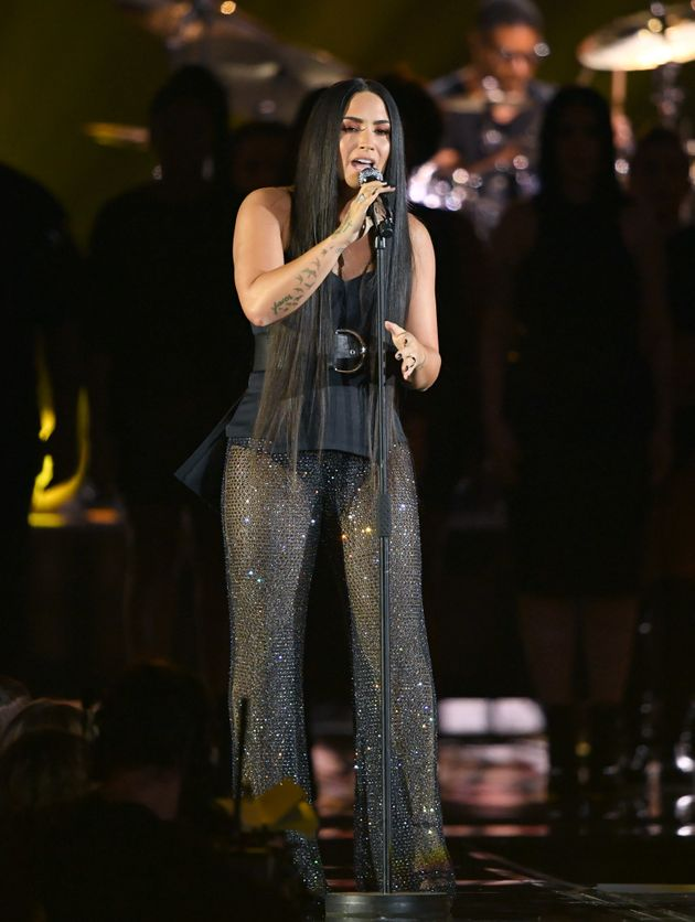 Lovato performing at the MTV