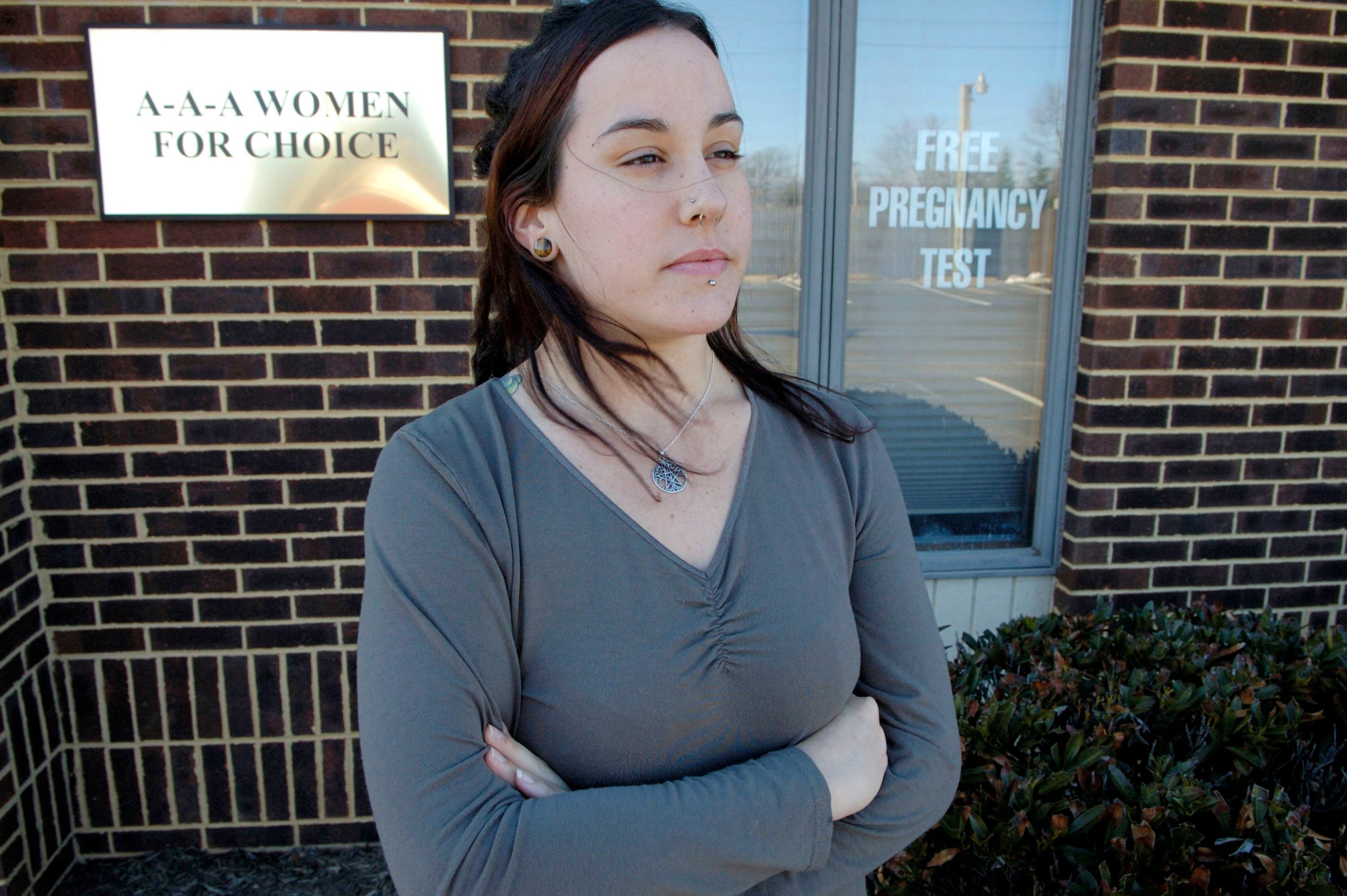 Allyson Kirk, 24, stands outside the A-A-A Women For Choice clinic, a crisis pregnancy center, March 2, 2007, in Manassas, Virginia. Kirk, who opted for an abortion at another clinic, is among many women who feel misled by the pregnancy centers.  (Photo by Stephanie Kuykendal/Chicago Tribune/MCT via Getty Images)