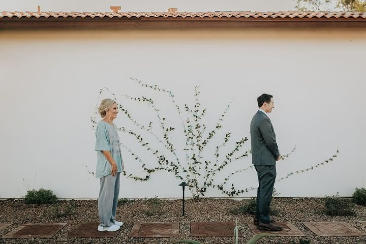 Newlyweds Erin and Ean Goldberg pose for hilarious first look wedding dress photo.
