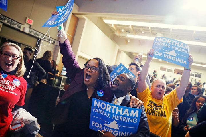 Supporters of Democratic gubernatorial candidate Ralph Northam celebrate as results start to come in at Northam's election ni