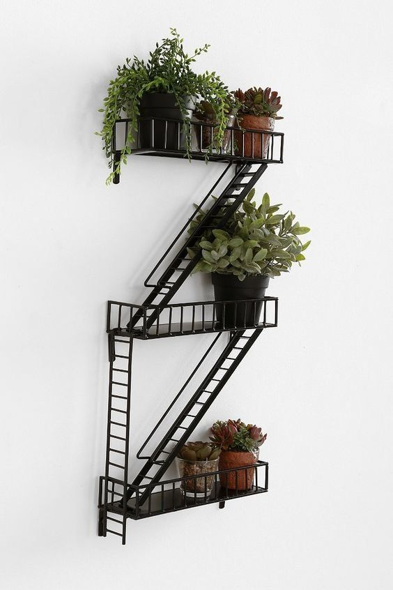"""<a href=""""https://www.uncommongoods.com/product/fire-escape-shelf"""" target=""""_blank"""">Buy ithere</a>for $99."""
