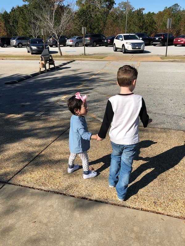 """My daughter has been home two weeks. My son has been waiting for her to come home for two years. Today he grabbed her hand a"