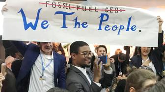 Protesters interrupt a U.S. government pro-coal event during the COP23 UN Climate Change Conference 2017, hosted by Fiji but held in Bonn, Germany, November 13, 2017.  REUTERS/Alister Doyle