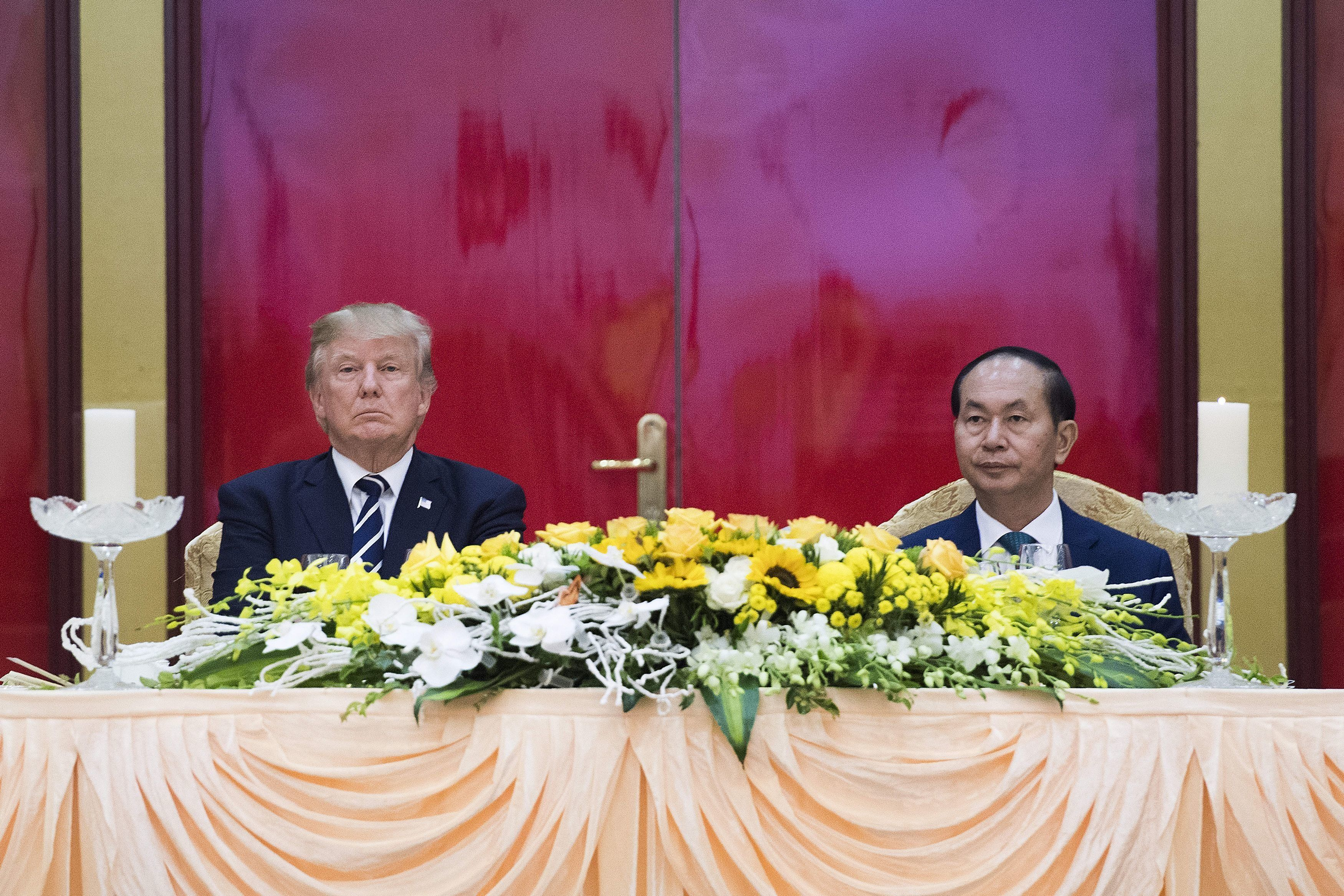Vietnamese President Tran Dai Quang (R) and US President Donald Trump attend a state dinner in Hanoi on November 11, 2017.  Trump arrived in the Vietnamese capital after attending the Asia-Pacific Economic Cooperation (APEC) Summit leaders meetings earlier in the day in Danang. / AFP PHOTO / JIM WATSON        (Photo credit should read JIM WATSON/AFP/Getty Images)