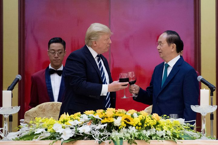 Vietnamese President Tran Dai Quang toasts President Donald Trump during a state dinner in Hanoi on Nov. 11, 2017.