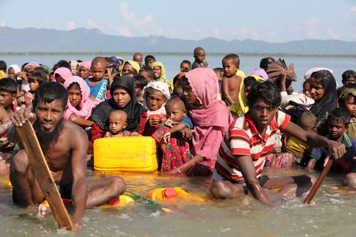 Rohingya refugees cross the Naf River with an improvised raft to reach to Bangladesh at Sabrang near Teknaf, Bangladesh Novem
