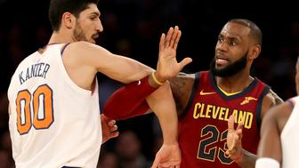 NEW YORK, NY - NOVEMBER 13:  Enes Kanter #00 of the New York Knicks and LeBron James #23 of the Cleveland Cavaliers fight for position at Madison Square Garden on November 13, 2017 in New York City. NOTE TO USER: User expressly acknowledges and agrees that, by downloading and or using this Photograph, user is consenting to the terms and conditions of the Getty Images License Agreement  (Photo by Elsa/Getty Images)