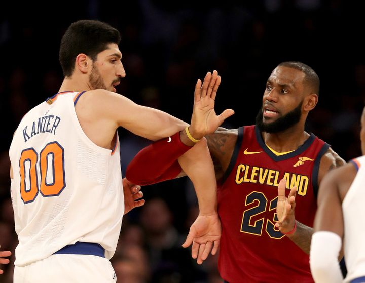 Enes Kanter and LeBron James fight for position during the Cleveland Cavaliers' 104-101 victory.