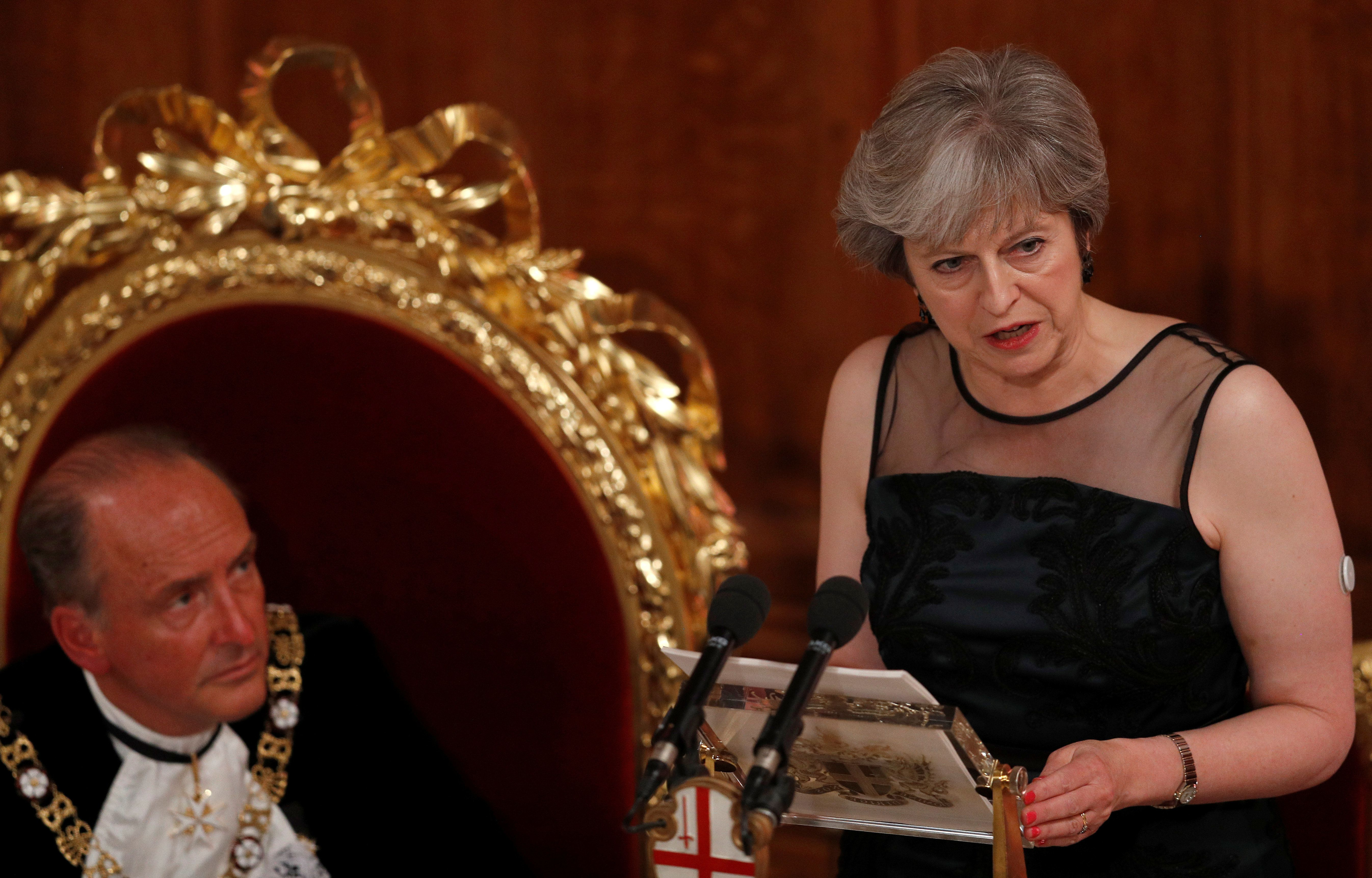 <strong>Theresa May warned of Russian interference in British politics at the Lord Mayor's Banquet at the Guildhall on Monday; Lord Mayor of the City of London, Charles Bowman, listens watches on</strong>