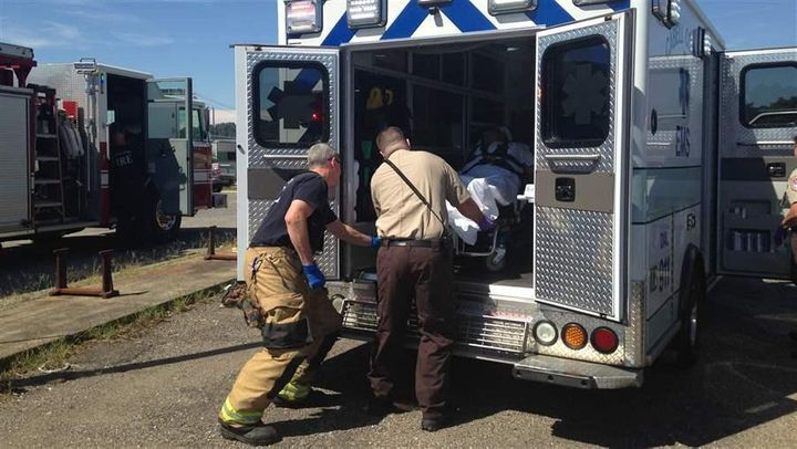 First responders in Huntington, West Virginia, put a patient in an ambulance after rescuing her from an apparent heroin overd
