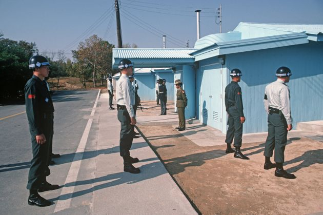 South Koreans and American soldiers at Panmunjom, the Korean demilitarised