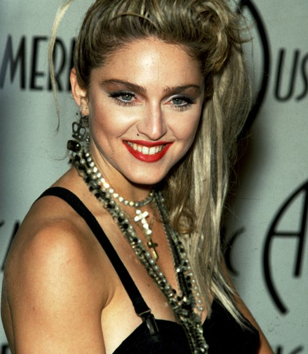 Madonna, pictured here in 1985, often wore crosses and even rosary beads around her neck in the early...
