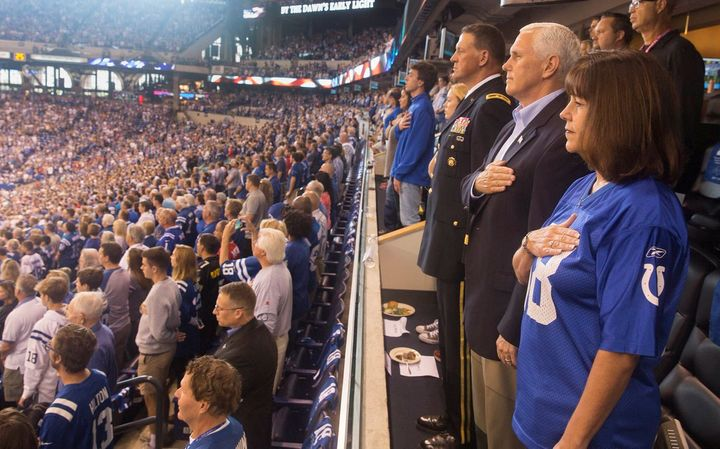 Vice President Mike Pence and wife Karen Pence stand during the national anthem prior to the start of an NFL football game.