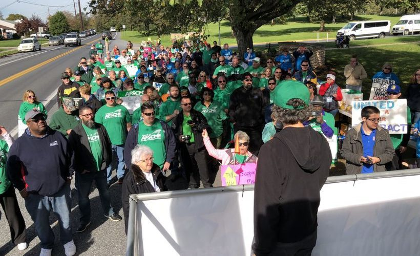 AFSCME Secretary-Treasurer Elissa McBride speaks at a rally on the picket line with the nurses, staff and residents of Cedar