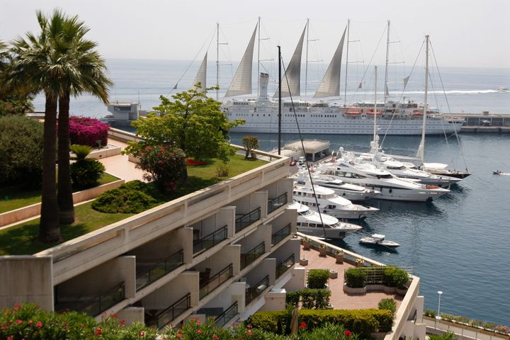 Luxury boats are moored in Monte Carlo, Monaco, July 2, 2009. The world's top 1 percent owns more than half of the world's ho
