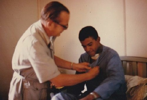 Being awarded the Combat Infantry Badge  in 3rd Field Hospital after being wounded, Saigon, 1969.