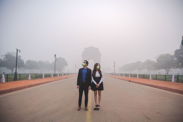 The couple in the smog-filled city.