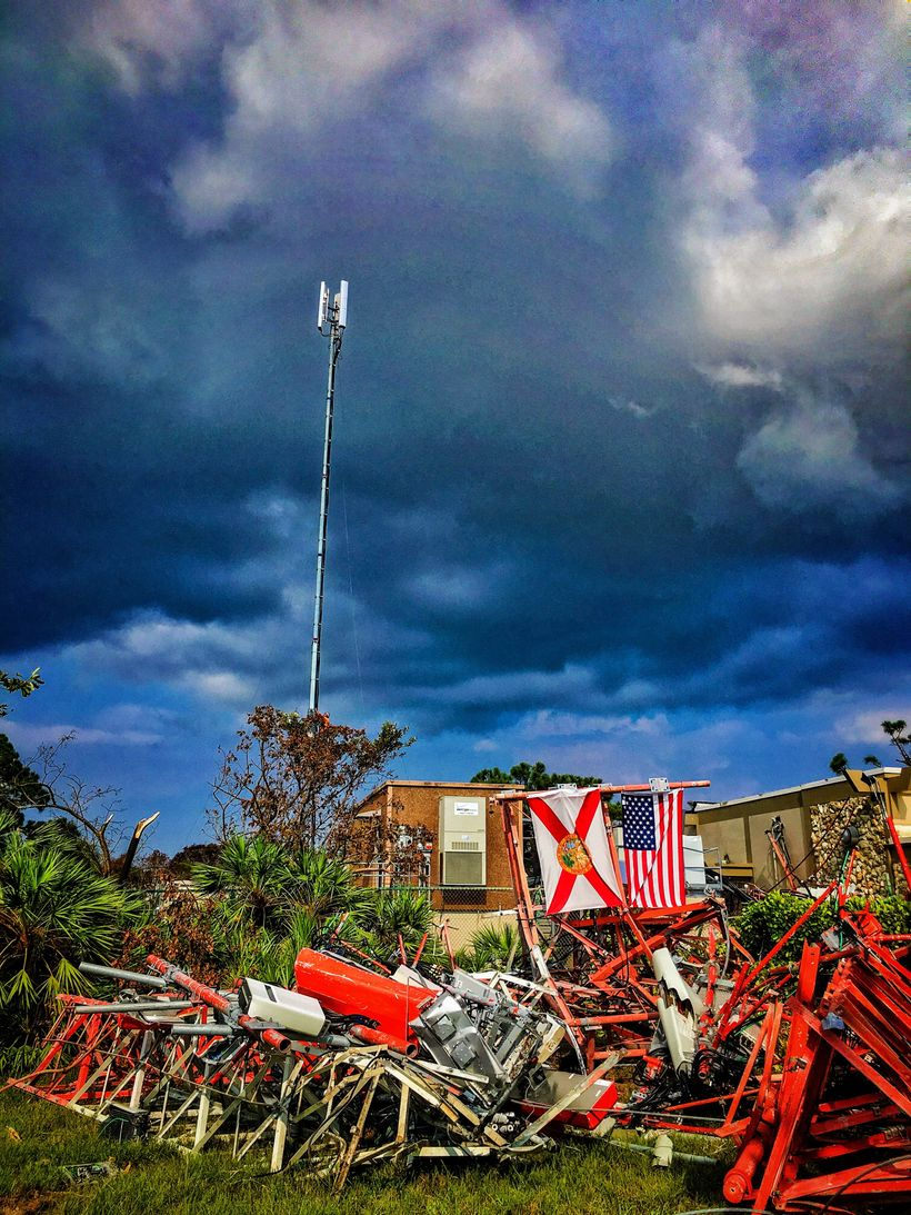 This cell tower on Marco Island, Florida was destroyed by Hurricane Irma. Despite the wind-swept damage, the equipment contin