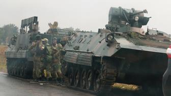 REFILE - CORRECTING TYPO IN SLUG  Soldiers stand beside military vehicles just outside Harare, Zimbabwe, November 14,2017. REUTERS/Philimon Bulawayo