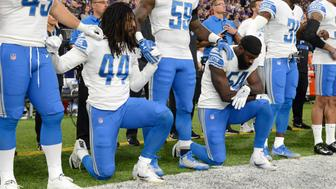 MINNEAPOLIS, MN - OCTOBER 1: Jalen Reeves-Maybin #44 of the Detroit Lions and teammate Steve Longa #54 take a knee during the national anthem before the game against the Minnesota Vikings on October 1, 2017 at U.S. Bank Stadium in Minneapolis, Minnesota. (Photo by Hannah Foslien/Getty Images)