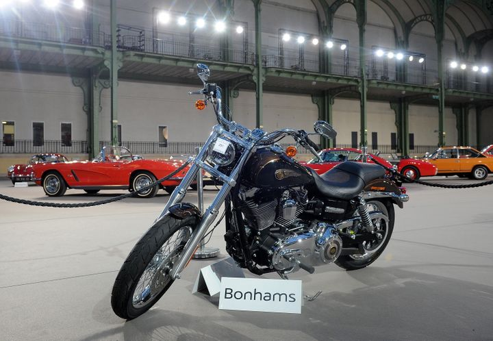 The 2013 Harley Davidson 1 585 cm3 Dyna Super Glide Custom that was donated to Pope Francis is seen on display ahea