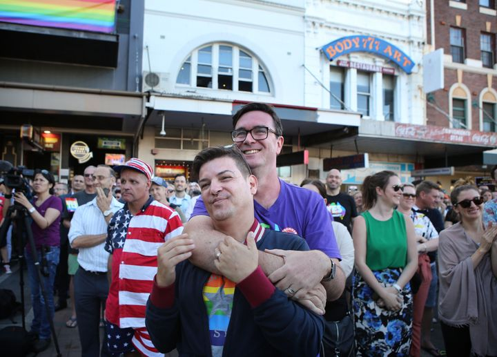 Victor De Sousa (left) and Chris Murray share the moment in Taylor Square in Sydney.