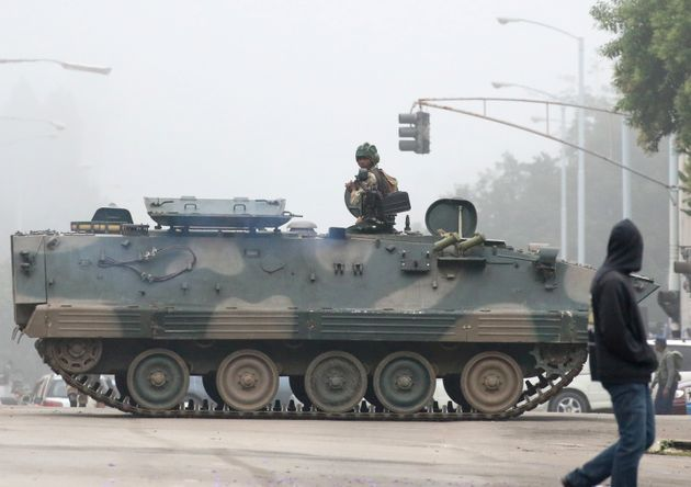 Military vehicles and soldiers patrol the streets in Harare on Nov.
