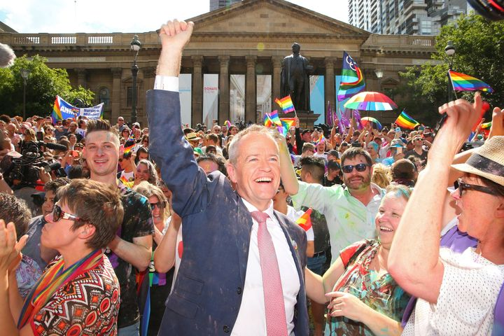 The leader of Australia's Labor Party, Bill Shorten, joins the cheering at the state library as the results of the nationwide