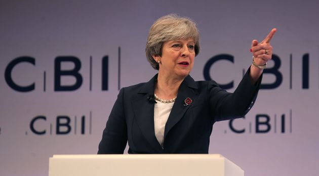Theresa May addresses delegates at the annual Confederation of British Industry (CBI) conference in east...