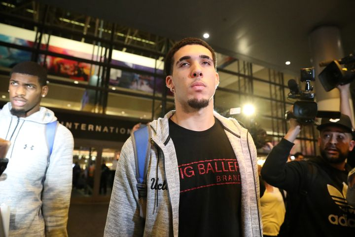 UCLA basketball player LiAngelo Ball is seen arriving in Los Angeles on Tuesday after being detained in China on suspicion of