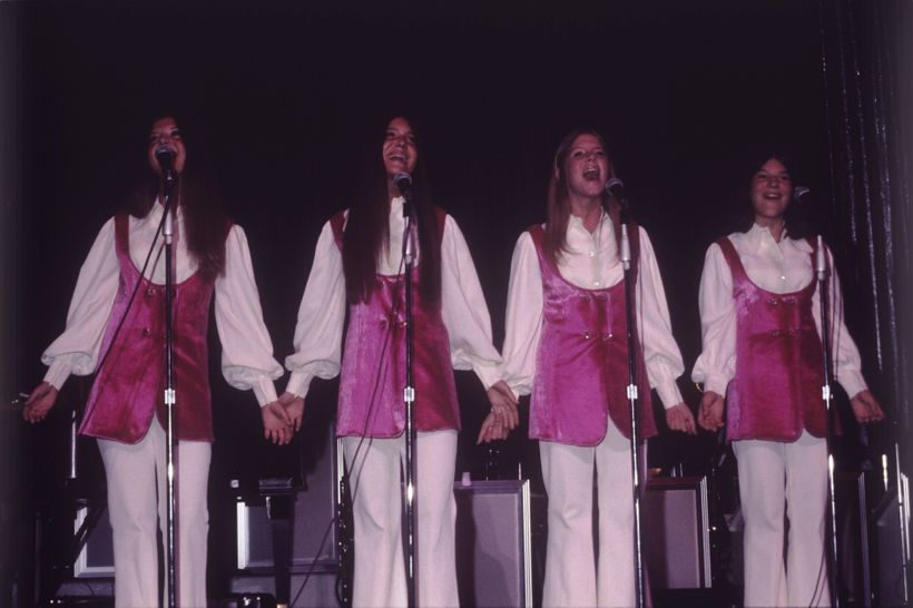 Debby Boone is second from right, performing in concert with her sisters Cherry, Lindy and Laury in 1971 as The Boone Girls.