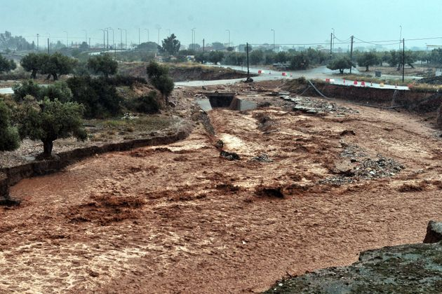 A picture shows damage and floodwaters in the town of