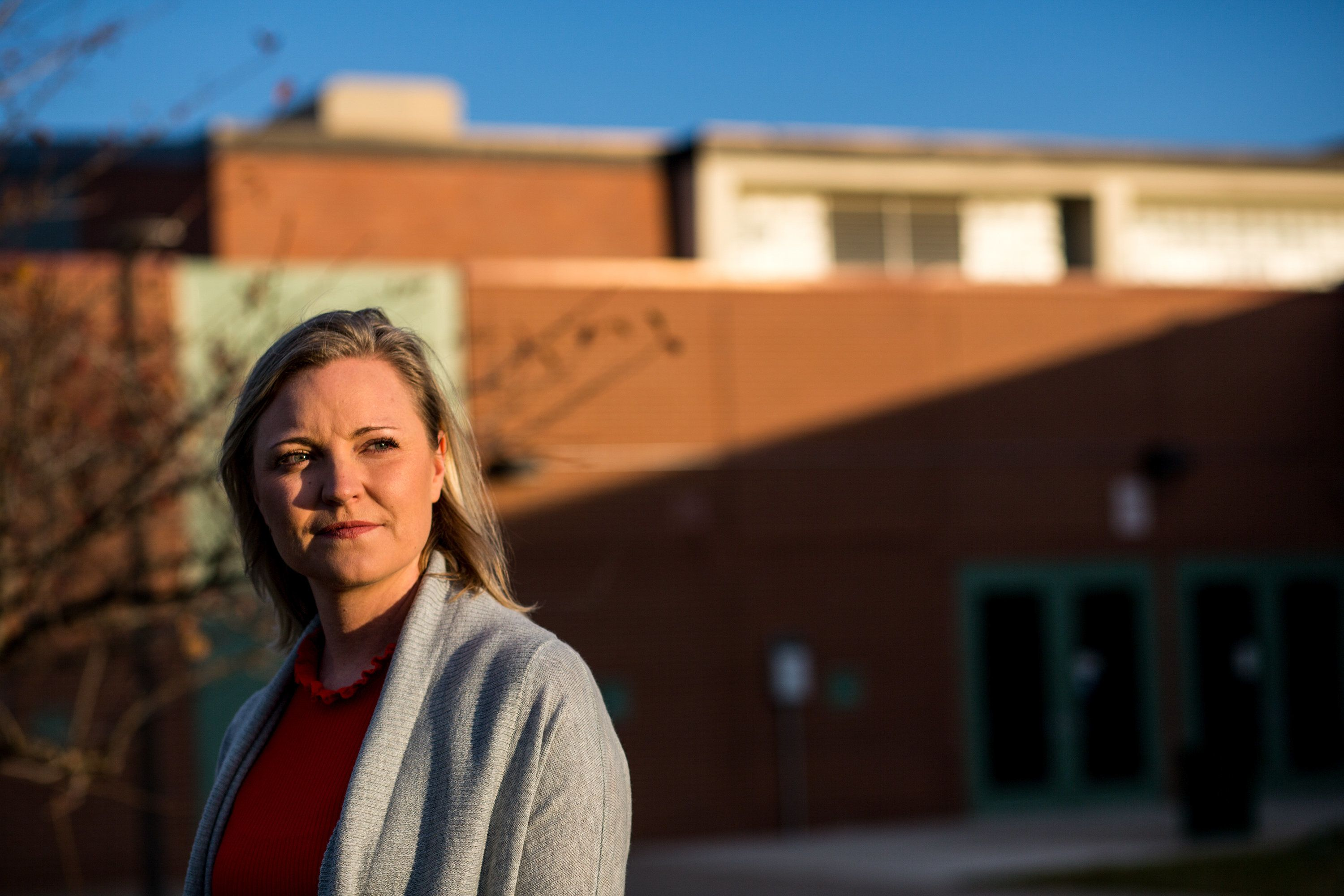 Heather Martin poses for a portrait at Aurora Central High School, where she teaches 12th grade English, in Aurora, Colo. on Nov. 8, 2017. Martin is a survivor of the Columbine High School shooting in 1999. She is now the co-founder of the Rebels Project which provides support to survivors in the aftermath of a shooting. (Photo by Autumn Parry)
