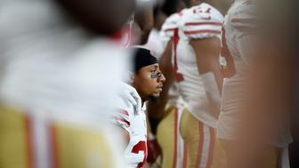 MINNEAPOLIS, MN - AUGUST 27: Eric Reid #35 of the San Francisco 49ers kneels dugout the National Anthem before the preseason game against the Minnesota Vikings on August 27, 2017 at U.S. Bank Stadium in Minneapolis, Minnesota. (Photo by Hannah Foslien/Getty Images)