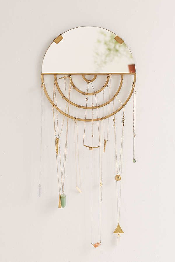 "<i>Buy it from <a href=""https://www.urbanoutfitters.com/shop/aimee-jewelry-storage-hanging-mirror?category=gift-ideas-for-wom"