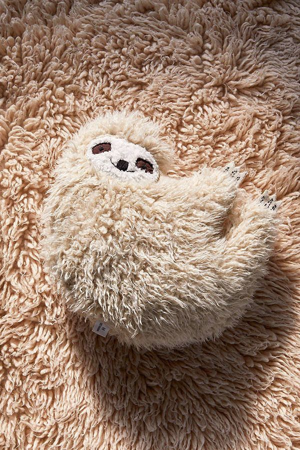 "<i>Buy it from <a href=""https://www.urbanoutfitters.com/shop/furry-sloth-pillow?category=gift-ideas-for-women&color=014&a"