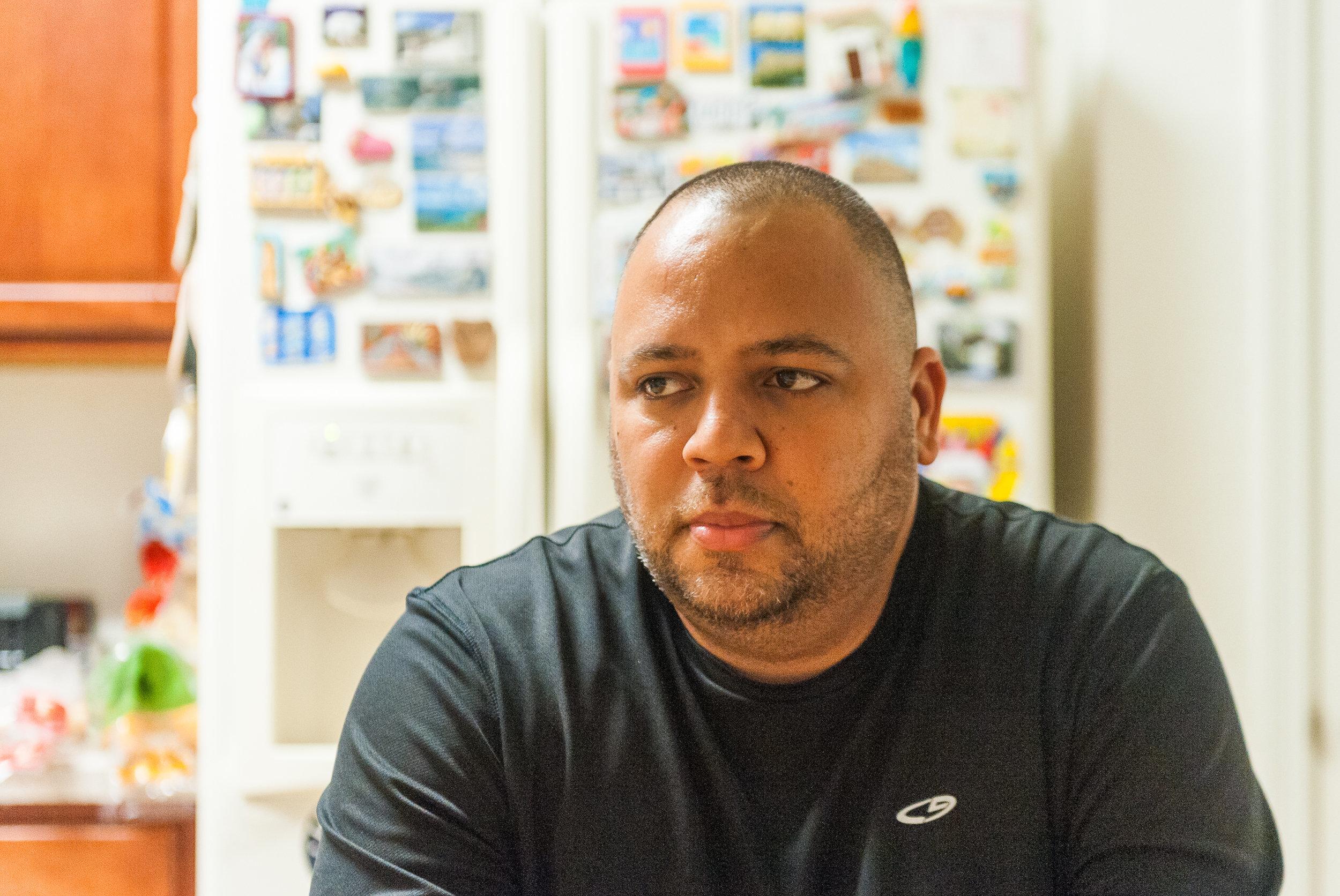 Omar Delgado poses for a photo at his home in Sanford Florida