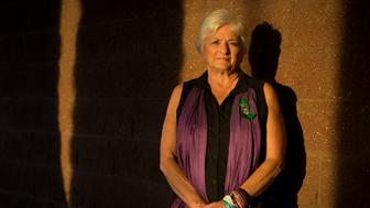 Patricia Maisch stands for a portrait on Nov. 12 at the Safeway supermarket that was part of the crime scene of the 2011 shooting in Tucson, Ariz. Maisch is a survivor of the mass shooting in which six people were killed and thirteen injured, including U.S. Rep. Gabrielle Giffords.