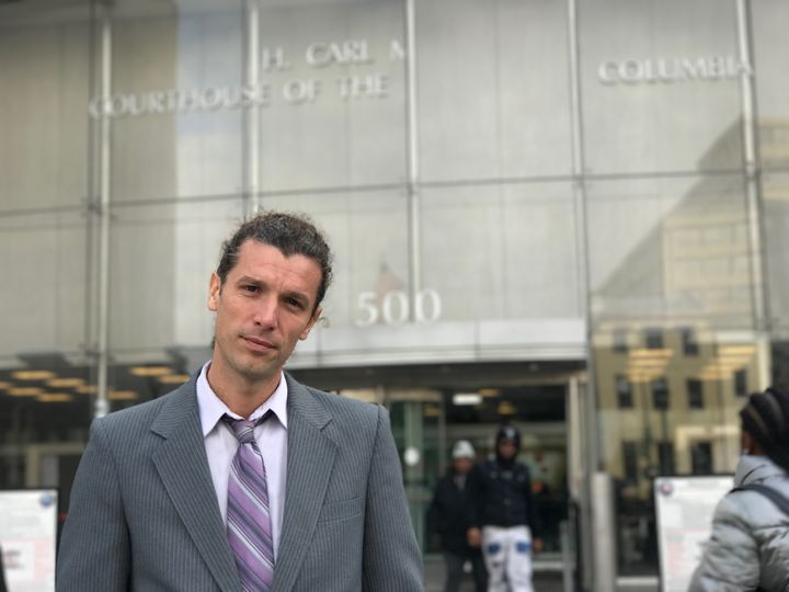 Alexei Wood stands outside D.C. Superior Court.